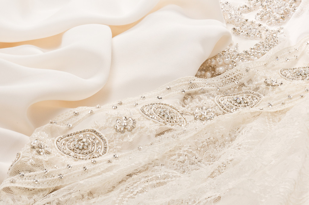 Closeup ivory cloth for wedding dress with pearl' beads pattern